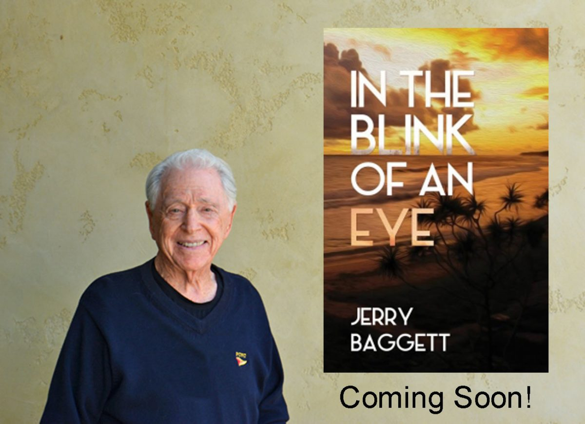 Jerry Baggett with his latest book In The Blink Of An Eye.